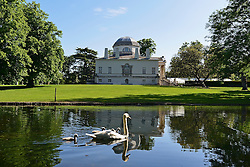 © Licensed to London News Pictures. 02/06/2013. London, UK A family of swans in the early morning sunshine on the watercourse against the backdrop of the Recently restored Chiswick house. . People enjoy the sunshine in the grounds of Chiswick house, West London, today 2nd June 2013. Photo credit : Stephen Simpson/LNP