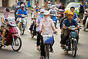 09 MARCH 2006 - HO CHI MINH CITY, VIETNAM: Motorcycle traffic in Ho Chi Minh City (formerly Saigon) Vietnam. Vietnam's recent economic expansion has led to prosperity not seen since the US  war in Vietnam in the 1960s and when most people once got around on bicycles, now many are buying motorcycles and scooters. This has led to increased pollution and constant traffic jams. PHOTO BY JACK KURTZ