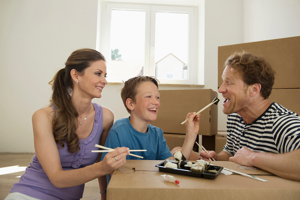 Moving in transport young family eating sushi