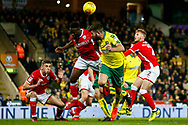 Norwich City defender Grant Hanley (31) heads the ball Barnsley midfielder Andy Yiadom (17) defending during the EFL Sky Bet Championship match between Norwich City and Barnsley at Carrow Road, Norwich, England on 18 November 2017. Photo by Phil Chaplin.