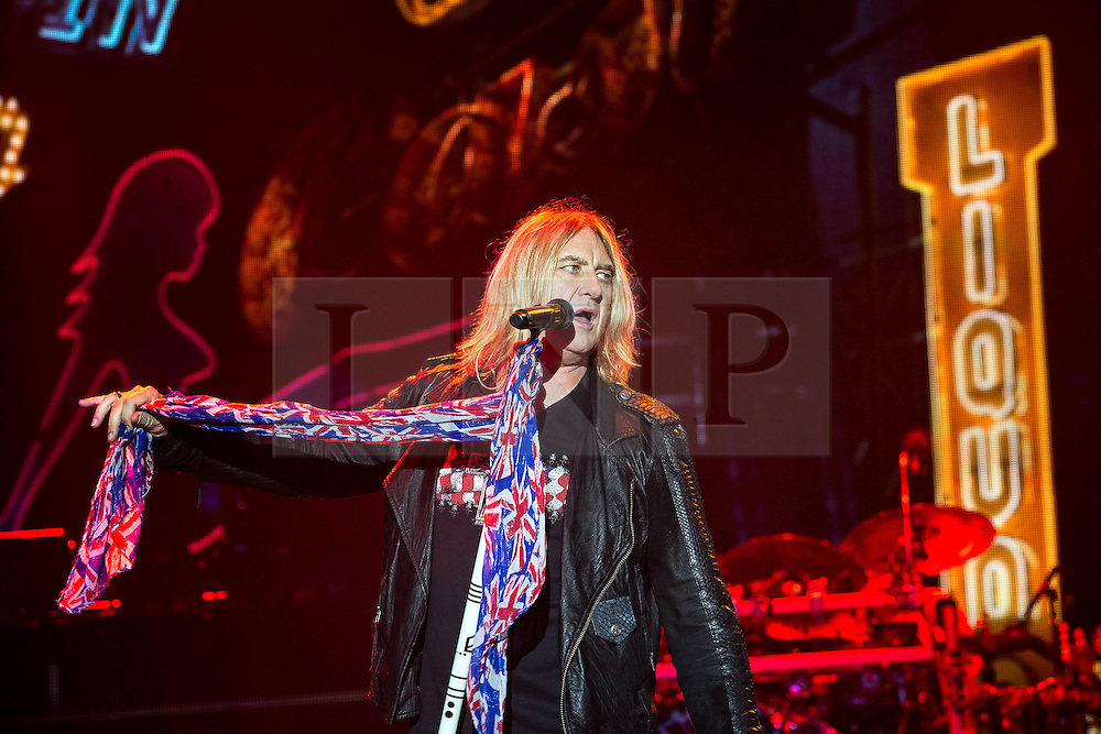 © Licensed to London News Pictures . 15/12/2015 . Manchester , UK . JOE ELLIOTT . Def Leppard perform at the Manchester Arena . Photo credit : LNP