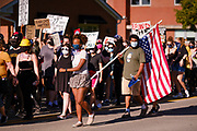 28 JULY 2020 - DES MOINES, IOWA: 28 JULY 2020 - DES MOINES, IOWA: A Black Lives Matter march moves up Grand Ave towards the Governor's Mansion in Des Moines. About 150 supporters of Black Lives Matter marched from downtown to Des Moines to the Governor's Mansion. They were demanding that Iowa Governor Kim Reynolds restore the voting rights for felons who have completed their sentence. In June, Reynolds met with representatives of Black Lives Matter and promised to sign an executive order to restore voting rights, but she hasn't said anything more about it in six weeks. Iowa is now the only state in the US that permanently strips felons of their voting rights. That means 60,000 people in Iowa can't vote.     PHOTO BY JACK KURTZ     PHOTO BY JACK KURTZ