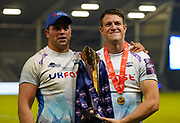 Sale Sharks centre Sam James with Jono Ross pose with the trophy after their 27-19 victory in The Premiership Rugby Cup Final at The AJ Bell Stadium, Eccles, Greater Manchester, United Kingdom, Monday, September 21, 2020. (Steve Flynn/Image of Sport)