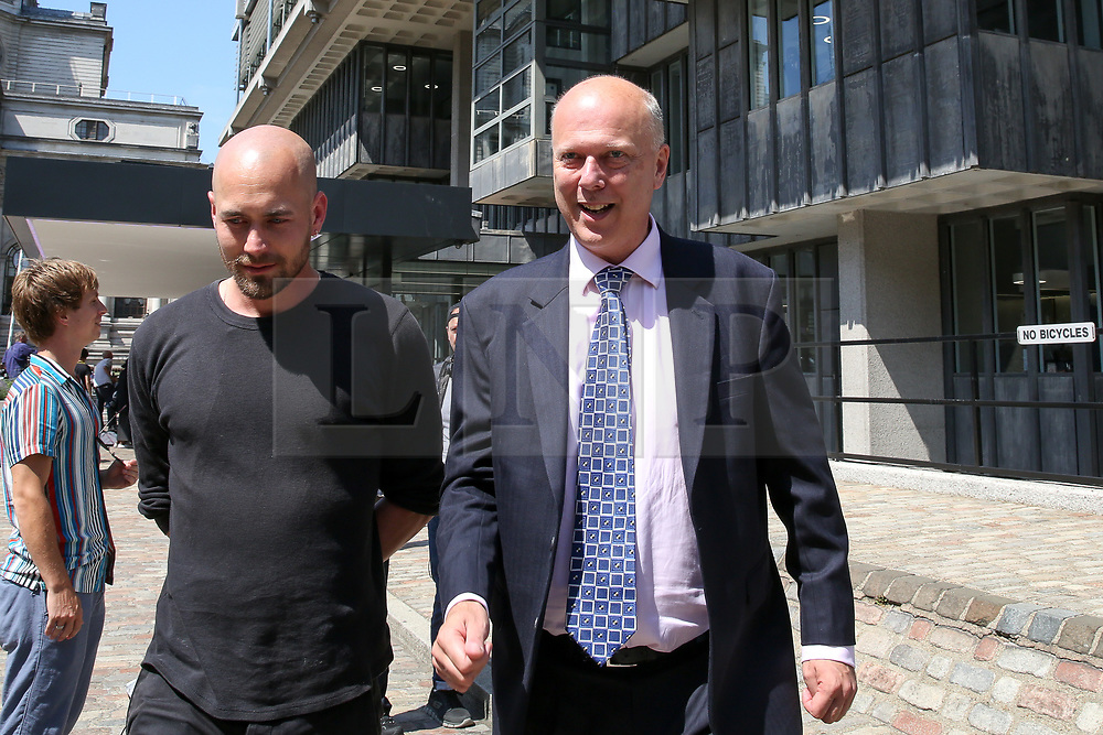 © Licensed to London News Pictures. 23/07/2019. London, UK. Secretary of State for Transport Chris Grayling leaves QEII Centre after Boris Johnson elected as leader of the  Conservative Party and the new British Prime Minister. Dinendra Haria/LNP