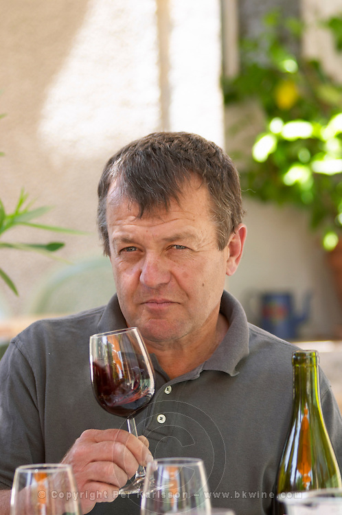 André Leenhardt Domaine Cazeneuve in Lauret. Pic St Loup. Languedoc. Owner winemaker. Tasting wine. France. Europe. Wine glass.