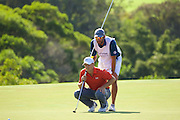 January 09 2016: Jordan Spieth and Michael Greller line up the eagle putt on eighteen during the Third Round of the Hyundai Tournament of Champions at Kapalua Plantation Course on Maui, HI. (Photo by Aric Becker)