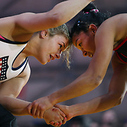 Women wrestlers Helen Maroulis, (left), USA, in action against  Marcia Andrades, Venezuela, during the 'Beat The Streets' USA Vs The World, International Exhibition Wrestling in Times Square. New York, USA. 7th May 2014. Photo Tim Clayton