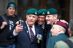 © Licensed to London News Pictures. 24/03/2017. London, UK. Former members of armed forces pose for a picture as they wait for Sergeant Alexander Blackman's sentencing outside the Royal Courts of Justice in London. The decision is delayed until next Tuesday. Also known as Marine A, Sgt Blackman's life sentence was reduced to manslaughter for killing a wounded Taliban fighter in Afghanistan in 2011. Photo credit: Tolga Akmen/LNP