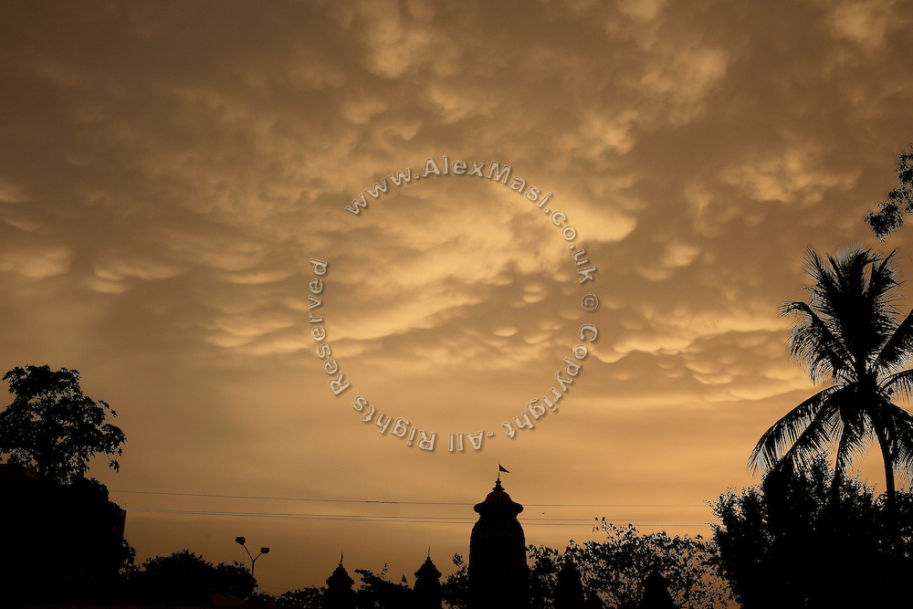 The Mukteswar temple is seen against an orange sky in the city of Bhubaneswar, the capital of Orissa State, India, on Saturday, May 17, 2008. Bhubaneswar is also known as the City of Temples as they are widely present in the city. **Italy and China Out**