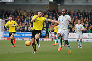 Burton Albion defender John Mousinho (4) and Norwich City forward Cameron Jerome during the EFL Sky Bet Championship match between Burton Albion and Norwich City at the Pirelli Stadium, Burton upon Trent, England on 18 February 2017. Photo by Richard Holmes.