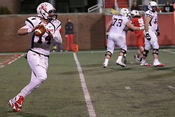11 December 2015:  David Broadus hasn't much more than the end zone to work with as a backfield as he looks for a receiver. NCAA FCS Quarter Final Football Playoff game between Richmond Spiders and Illinois State Redbirds at Hancock Stadium in Normal IL (Photo by Alan Look)