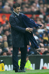 28th October 2017 - Premier League - Manchester United v Tottenham Hotspur - Spurs manager Mauricio Pochettino struggles with a towel - Photo: Simon Stacpoole / Offside.