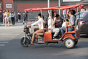 Electric powered moped or scooter<br /><br />Electric vehicles are everywhere on China's roads, from battery powered pedal bikes to hybrid cars, electric buses and all types of service vehicles.