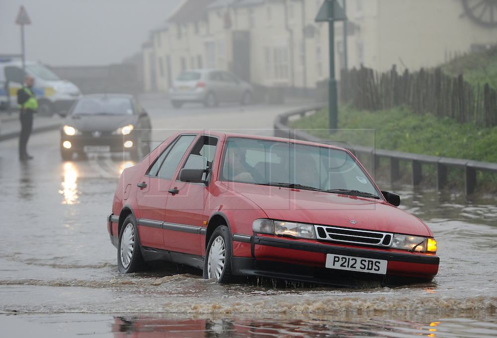 © Licensed to London News Pictures. 30/05/2013<br /> <br /> Saltburn, Cleveland, United Kingdom<br /> <br /> Drivers make their way through deep floods as heavy overnight rain causes flooding in Saltburn on the A174 coast road near to the Ship Inn on the seafront in the town.<br /> <br /> Photo credit : Ian Forsyth/LNP