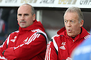Swansea city caretaker manager Alan Curtis (far right)  looks on from the dugout.  Barclays Premier league match, Swansea city v West Bromwich Albion at the Liberty Stadium in Swansea, South Wales  on Boxing Day Saturday 26th December 2015.<br /> pic by  Andrew Orchard, Andrew Orchard sports photography.