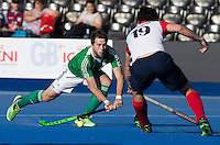 LONDON -  Unibet Eurohockey Championships 2015 in  London. 03 Ireland-France (4-3).  Kyle Good scores 1-0 . right French Francois Scheefer . WSP Copyright  KOEN SUYK