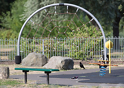 © Licensed to London News Pictures. 06/07/2018. Salisbury, UK. A discarded shoe is seen in a children's play area in the cordoned off Queen Elizabeth Gardens in Salisbury town centre after couple, named locally as Dawn Sturgess, 44, and her partner Charlie Rowley, 45, were taken ill on Saturday 30th June 2018. Police have confirmed that the couple have been in contact with Novichok nerve agent. Former Russian spy Sergei Skripal and his daughter Yulia were poisoned with Novichok nerve agent in nearby Salisbury in March 2018. Photo credit: Peter Macdiarmid/LNP