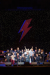 Images of iOTA, Tim Rogers, Steve Kilbey, Deborah Conway, Adalita, and Jack Ladder performing 'David Bowie Nothing Has Changed' with the Sydney Symphony Orchestra. <br /> <br /> The band are Ashley Naylor, Clayton Doley, James Haselwood, Davey Lane and Laurence Pike, with vocalists Robyn Loau and Jade McRae.<br /> <br /> Photos by Robert Catto, taken at the Sydney Opera House on Thursday 19  May, 2016.