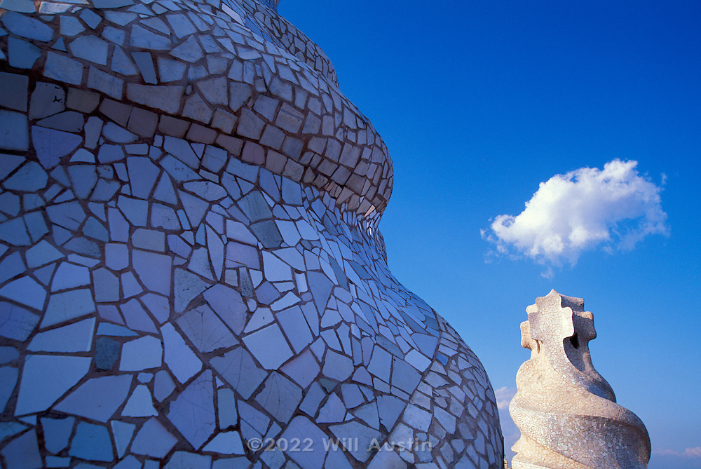 Rooftop forms of the Casa Mila building designed by Catalan architect Antoni Gaudi in the Eixample District of Barcelona, Spain.  Sometimes known as La Pedrera, it was completed in 1912.