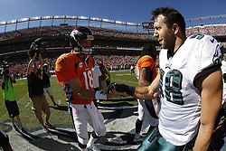 Philadelphia Eagles outside linebacker Connor Barwin #98 greets Denver Broncos quarterback Peyton Manning #18 at the coin toss before the NFL game between the Philadelphia Eagles and the Denver Broncos on Sunday, September 29th 2013 in Denver, Colorado. The Broncos won 52-20. This image was taken with a fisheye lens. (Photo by Brian Garfinkel)