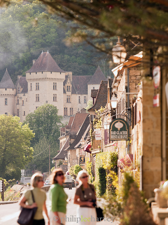 Chateau De Malartrie and local shops in La Roque Gageac, Dordogne, France