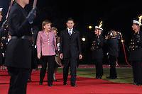 """24 MAR 2007, BERLIN/GERMANY:<br /> Angela Merkel (L), CDU, Bundeskanzlerin, und Joachim Sauer (R), Ehemann von A. Merkel, gehen an einer Formation von  Soldaten des Wachbataillons der Bundeswehr mit Fackeln vorbei zu einem Abendessen auf Einladung des Bundespraesidenten, im Rahmen des Treffens der Staats- und Regierungschefs der Europaeischen Union  anl. des 50. Jahrestages der """"Roemischen Vertraege"""" <br /> IMAGE: 20070324-03-014<br /> KEYWORDS: Ehepartner"""