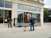 31 MAY 2020 - DES MOINES, IOWA: Workers clean up glass left after a window in a Vietnamese restaurant was shattered by rioters in downtown Des Moines Sunday. A group of rioters, protesting the death of George Floyd in police custody in Minneapolis, smashed windows in businesses and restaurants around the Polk County Courthouse in Des Moines. Des Moines police said they made 25 arrests Saturday night and very early Sunday morning. No one was hurt in the disturbances.    PHOTO BY JACK KURTZ