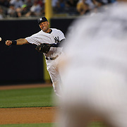 Derek Jeter, New York Yankees, throws to Mark Teixeira, at first base after committing an error while fielding at shortstop in the fourth inning off a Devin Mesoraco hit during the New York Yankees Vs Cincinnati Reds baseball game at Yankee Stadium, The Bronx, New York. 18th July 2014. Photo Tim Clayton
