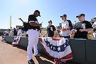 GLENDALE, AZ - MARCH 5:  Dayan Viciedo #24 of the Chicago White Sox signs autographs before the game against the Los Angeles Dodgers on March 5, 2010 at The Ballpark at Camelback Ranch in Glendale, Arizona. (Photo by Ron Vesely)