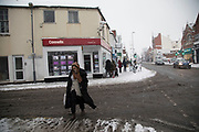 People in King Heath head during heavy snow fall on Sunday 10th December 2017 in Birmingham, United Kingdom. Deep snow arrived in much of the UK, closing roads and making driving treacherous, while many people simply enjoyed the weather.