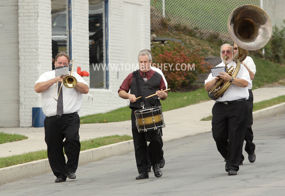 Middletown, New York - A Dixieland band marches in the funeral procession for Willie Carter on West Main Street on Sept. 19, 2010.