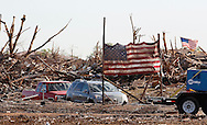 The American flag from the Plaza Towers elementary school is erected on poles in front of whats left of the school in Moore, Oklahoma May 22, 2013. A massive tornado tore through a suburb of Oklahoma City, wiping out whole blocks and killing at least 24.   REUTERS/Rick Wilking (UNITED STATES)