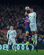 Leo Messi of Barcelona fight in the air for the ball with Varane,during the first match of the Spanish King's Cup semifinal at Camp Nou Stadium in Barcelona,Spain,6 February 2019