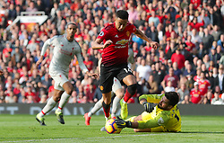 Manchester United's Jesse Lingard (left) and Liverpool goalkeeper Alisson Becker battle for the ball