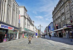 © Licensed to London News Pictures. 23/03/2020. Newcastle, UK. Northumberland Street in Newcastle is almost deserted at 10am as people stay away during the coronavirus pandemic. Photo credit: Colin Scarr/LNP