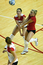 19 AUG 2006 Redbirds Kelly Waterstraat and Libero Kasey Mollerus both go after the same ball. Northern Illinois Huskies got slammed by Illinois State Redbirds, losing the match 3 games to 1. Game action took place at Redbird Arena on the campus of Illinois State University in Normal Illinois.