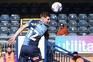 Wycombe Wanderers defender (on loan from Leicester City) Josh Knight (12) heads the ball  during the EFL Sky Bet Championship match between Wycombe Wanderers and Norwich City at Adams Park, High Wycombe, England on 28 February 2021.
