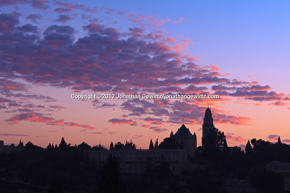 The Dormition Abbey on Jerusalem's Mount Zion in dramatic light shortly before dawn. WATERMARKS WILL NOT APPEAR ON PRINTS OR LICENSED IMAGES.