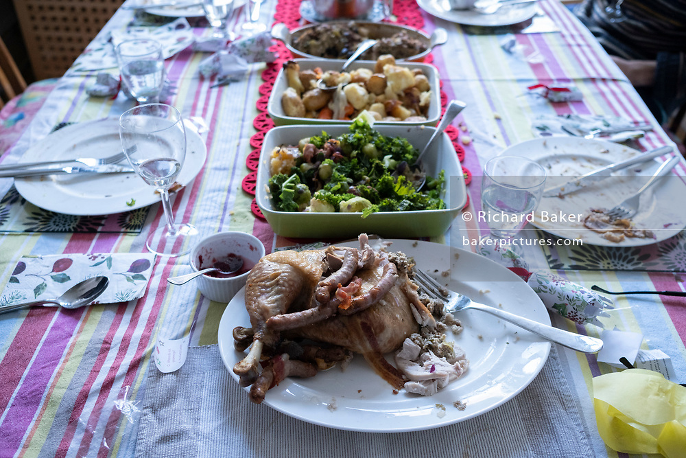 A table of food leftovers, the remains of Christmas excess on Christmas Day, on 25th December 2020 in London, England.