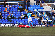 Peterborough Utd Forward Mohamed Eisa (7) fouls Wigan Athletic Defender Tendayi Darikwa (2) during the EFL Sky Bet League 1 match between Peterborough United and Wigan Athletic at London Road, Peterborough, England on 27 February 2021.