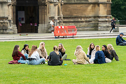 "© Licensed to London News Pictures; 22/09/2020; Bristol, UK. A group of 11 young people sit on College Green. Groups of people, some more than six in number, can still be seen in Bristol city centre, after the Prime Minister today announced new restrictions which could last for up to six months and also warned of significantly greater restrictions if necessary, amid concerns about a second wave of the covid-19 coronavirus pandemic across the UK. Penalties for gathering in groups of more than six will increase from £100 to £200 on the first offence. From Monday 14 September it was illegal to meet up socially in groups of more than six people, known as the ""Rule of Six"", in order to try and contain the spread of the covid-19 coronavirus pandemic, and police have said they will enforce the law with fixed penalty notices which will increase for repeat offenders. Photo credit: Simon Chapman/LNP."