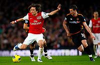 20111227: LONDON, UK - Barclays Premier League 2011/2012: Arsenal vS Wolverhampton Wanderers.<br /> In photo: Tomas Rosicky of Arsenal holds off Anthony Forde of Wolverhampton Wanderers.<br /> PHOTO: CITYFILES