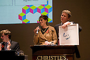 TRACEY EMIN; HELPING SELL HER WORK ' SEX 24 25-11-07 SYDNEY 2007' WITH AUCTIONEER  JUSSI PYLKKANEN, The Lighthouse Gala Auction in aid of the Terrence Higgins Trust. Christie's. 23 March 2009.