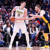 03 April 2018: Indiana Pacers center Domantas Sabonis (11) defends on Denver Nuggets center Nikola Jokic (15) during the Denver Nuggets 107-104 victory over the Indiana Pacers, at the Pepsi Center, Denver, Colorado, USA.