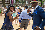 Well-dressed dancers on the dance floor at the Jazz Age Lawn Party.