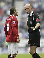 Photo: Aidan Ellis.<br /> Wigan Athletic v Manchester United. The Barclays Premiership. 14/10/2006.<br /> United's Wayne Rooney is spoke to by referee Howard Webb