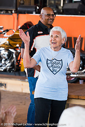 Still riding as a nonagenarian (90 year old,) Gloria Struck gets introduced to the crowd at Harley Davidson's Editor's Choice Bike Show at the Broken Spoke Saloon during Daytona Bike Week 75th Anniversary event. FL, USA. Wednesday March 9, 2016.  Photography ©2016 Michael Lichter.