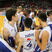 Anadolu Efes's players celebrate victory during their Turkish Basketball League Play Off Semi Final round 1 match Anadolu Efes between Trabzonspor at Abdi Ipekci Arena in Istanbul Turkey on Friday 29 May 2015. Photo by Aykut AKICI/TURKPIX