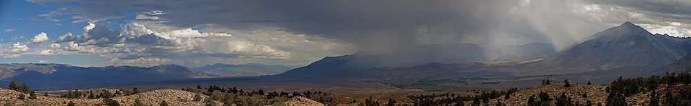 A thunderstorm over Mt. Tom, Sierra Nevada range, California.  The Owens Valley and the town of Bishop is on the left.