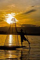 INLE LAKE, MYANMAR - DECEMBER 09, 2016 : Fisherman fishing at sunset on the Inle Lake Shan state in Myanmar (Burma)